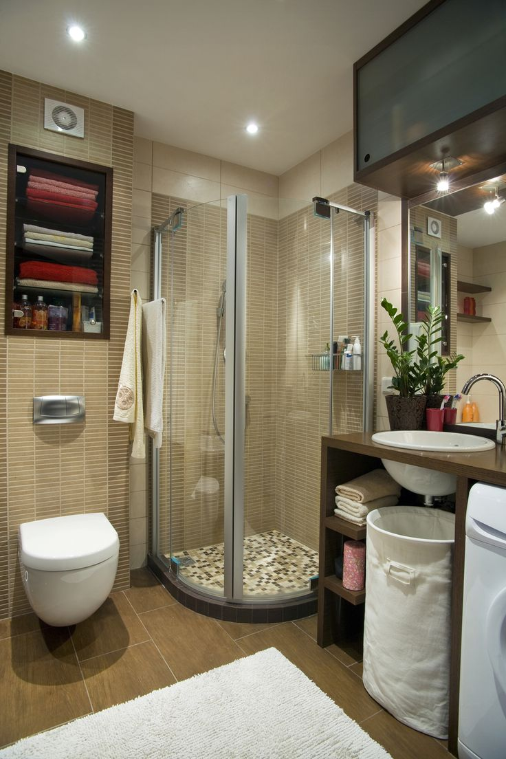 Very Space Efficient Bathroom  Small Spaces. Wall Hung Toilet, Smaller  Shower Stall, Over Vanity Cabinet, Under Sink Hamper, And A Washer Under  Sink Vanity.