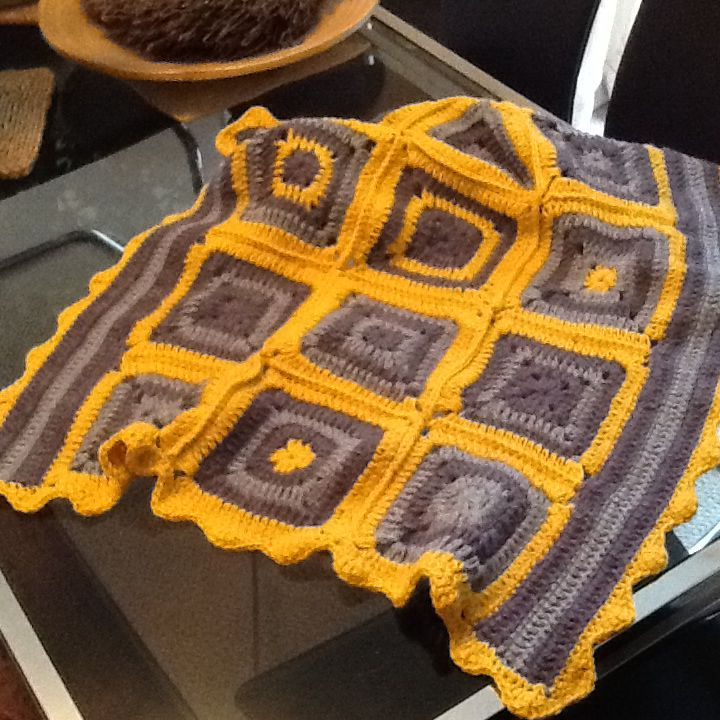 Just finished...phew! Crochet lap blanket in purple, blue and yellow.