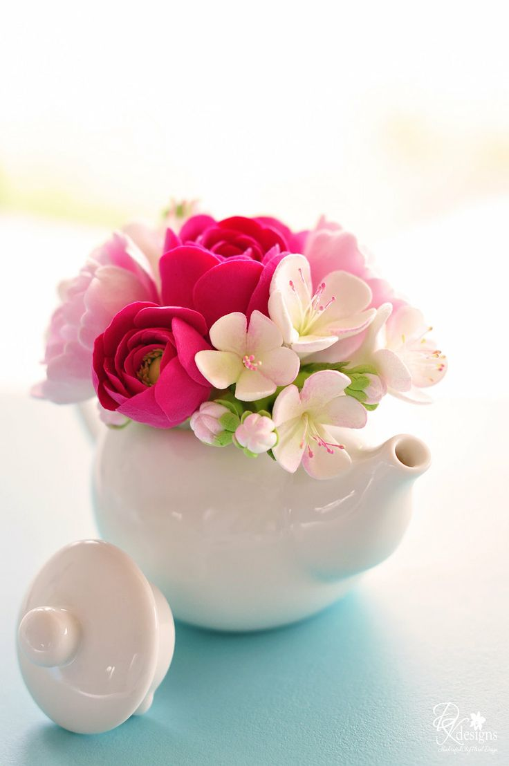 Mini Teapot Clay Flower Arrangement. Nice for year round spring/summer flowers