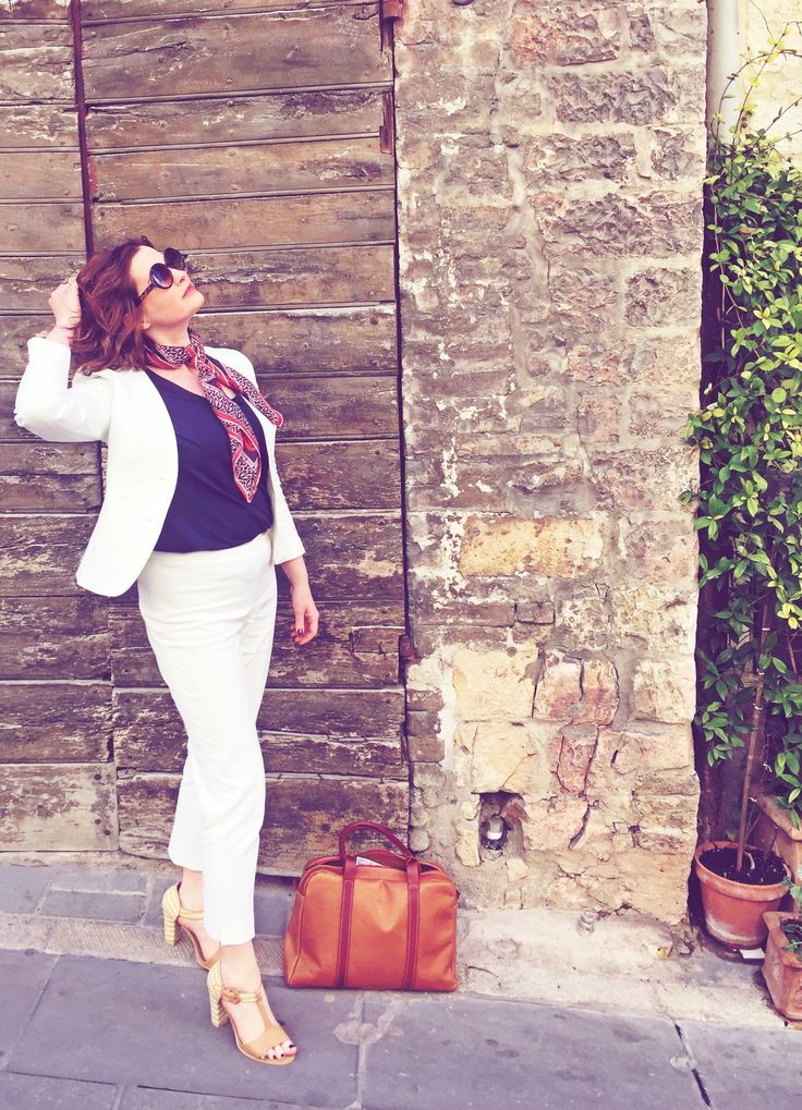White suit. Tan accessories  http://www.poutinginheels.com/a-bit-of-all-white-in-italy/