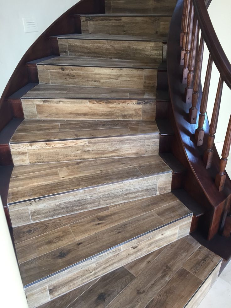 Wood Looking Tile With Newly Stained Banister Porcelain