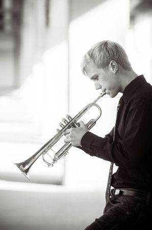 Senior portraits downtown. Playing a trumpet. Portrait Photographer - Ryan Davis Photography, Rockford, IL.