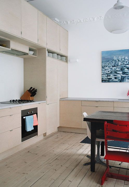 "Ikea appears again in this renovated, late-19th-century Oslo apartment. ""We used custom fir plywood doors to make the Ikea cabinets under the marble countertops special,"" the resident says of the kitchen.  Courtesy of Hans Petter.  This originally appeared in Budget-Friendly Renovation of a Neoclassical Home in Oslo."
