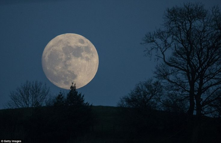 A so-called wolf moon rises over Glastonbury Tor, in Somerset, yesterday. In some parts of the world, the January full moon is nicknamed the wolf moon, which dates back to the days when Native American tribes gave names to each month's full moon to help keep track of the seasons