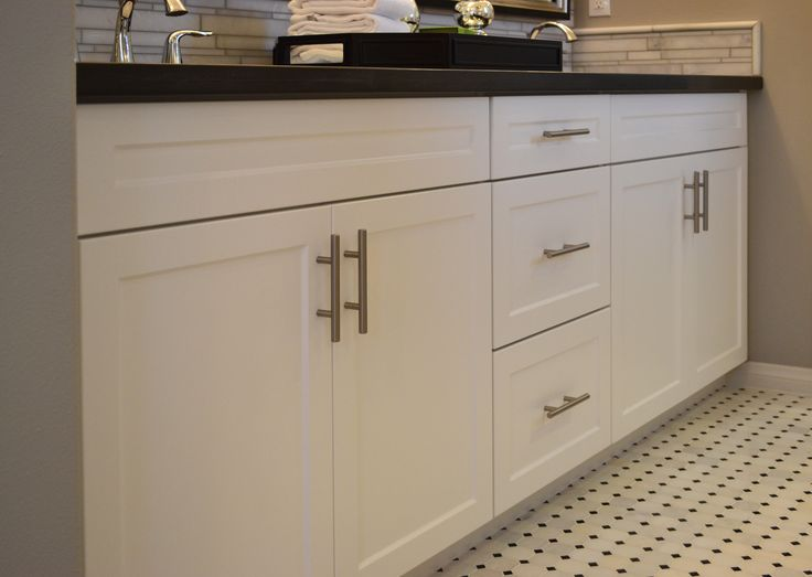 Mission Thermofoil Satin White frameless cabinetry with brushed nickel Gallery pulls.