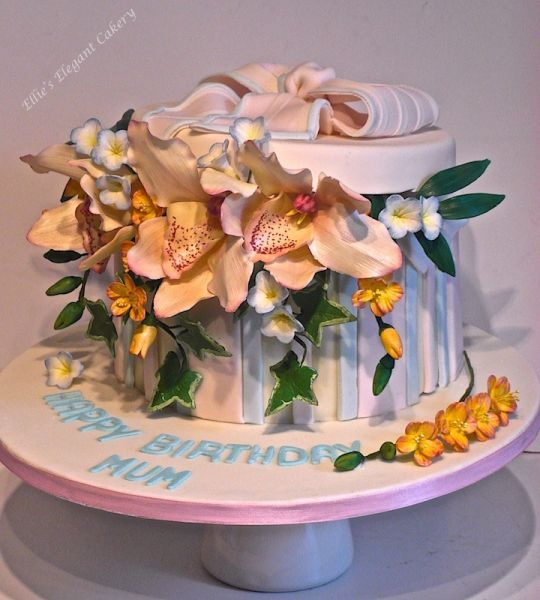 {Lovly way to display some Cymbidium Orchids in a pretty hat box cake by Ellie@ Ellie's Elegant Cakery}