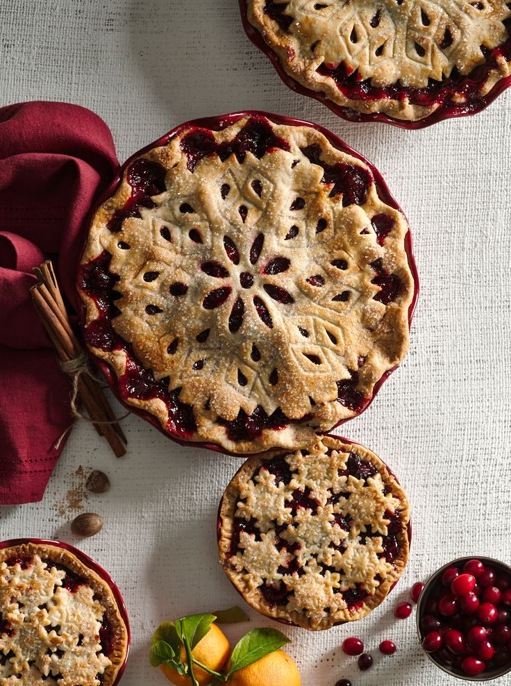 A stunning cranberry pie topped with a snowflake pie crust.
