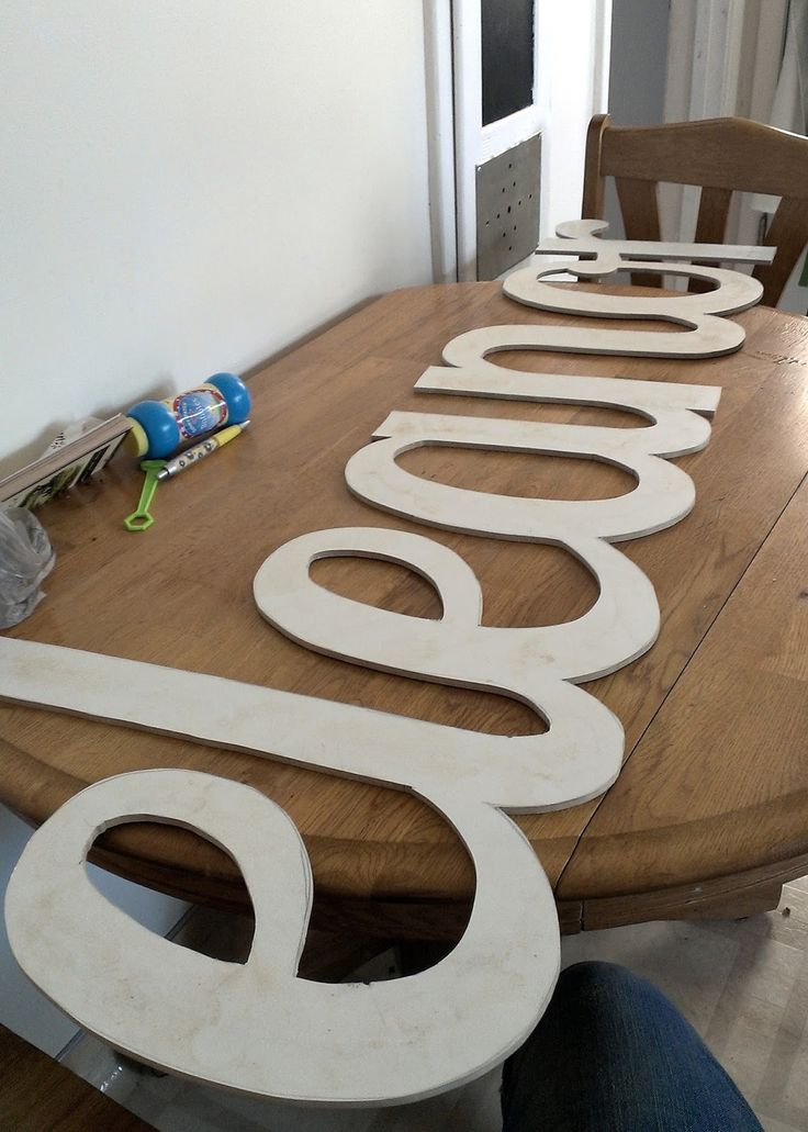 Dream Home: Giant script name cut out with a Dremel, sand, and paint. Awesome !