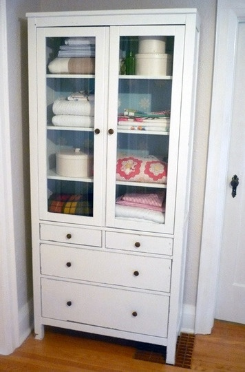 If there isn't a linen closet available, this glass front cabinet allows for storage of linens, towels, toiletries, etc. in a bathroom or hallway adjacent to a bathroom.