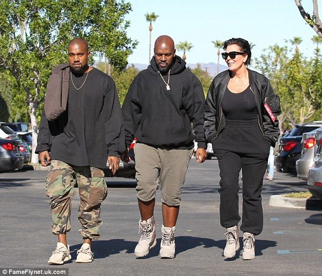 Three's no crowd: Kanye West was the perfect son-in-law when he accompanied Kris Jenner to the cinema along with her toyboy Corey Gamble in Calabasas on Saturday following her 60th birthday