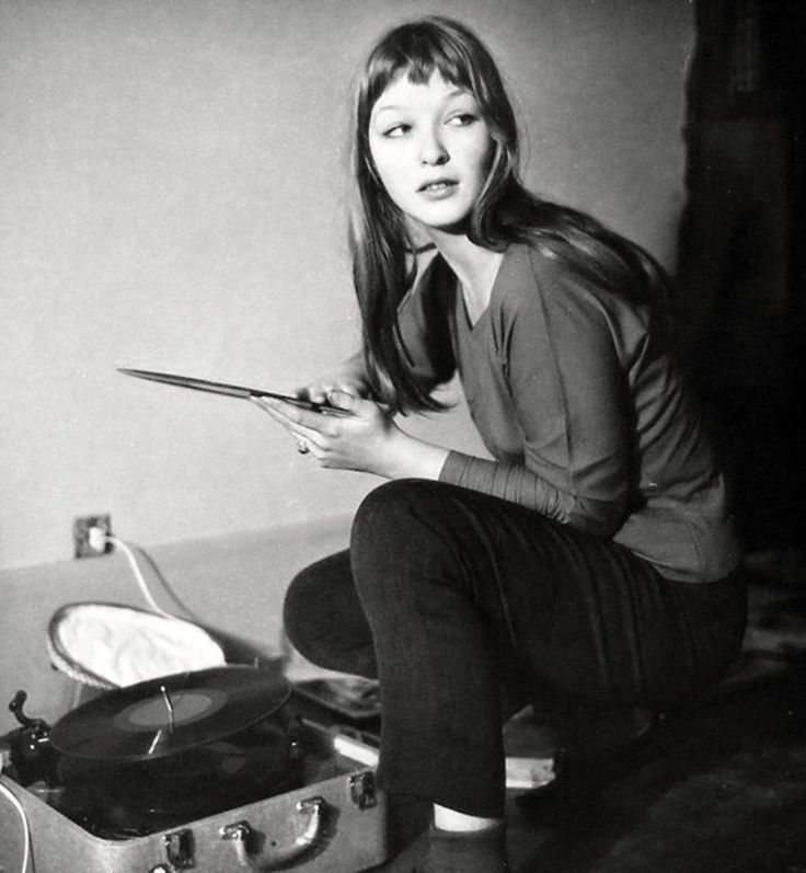 Actress Marina Vlady puts a record on, 1956