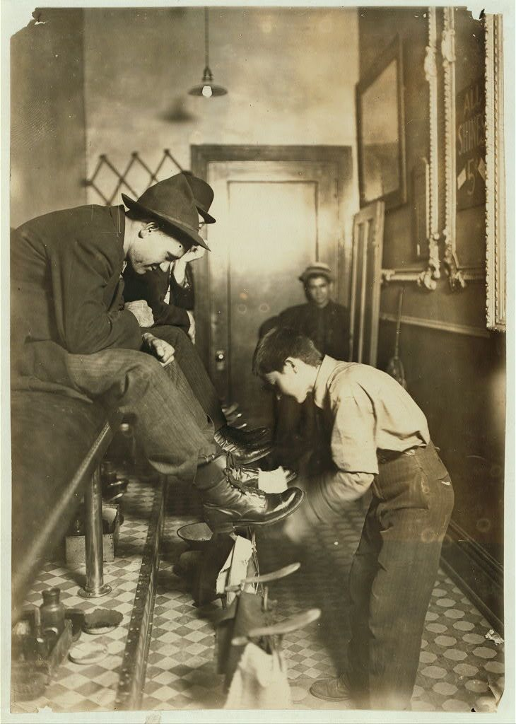 Greel's Shoe-shining Parlor, Indianapolis, Ind. Said he was 15 years old. Works some nights until 11. Taken at 10 P.M. Location: Indianapolis, Indiana. August 1908....photo Lewis Hine