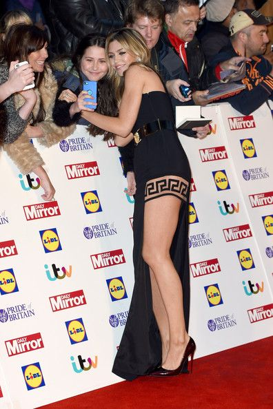 Abbey Clancy Photos Photos - Abbey Clancy poses with fans as she attends the Pride of Britain awards at The Grosvenor House Hotel on October 6, 2014 in London, England. - Pride of Britain Awards