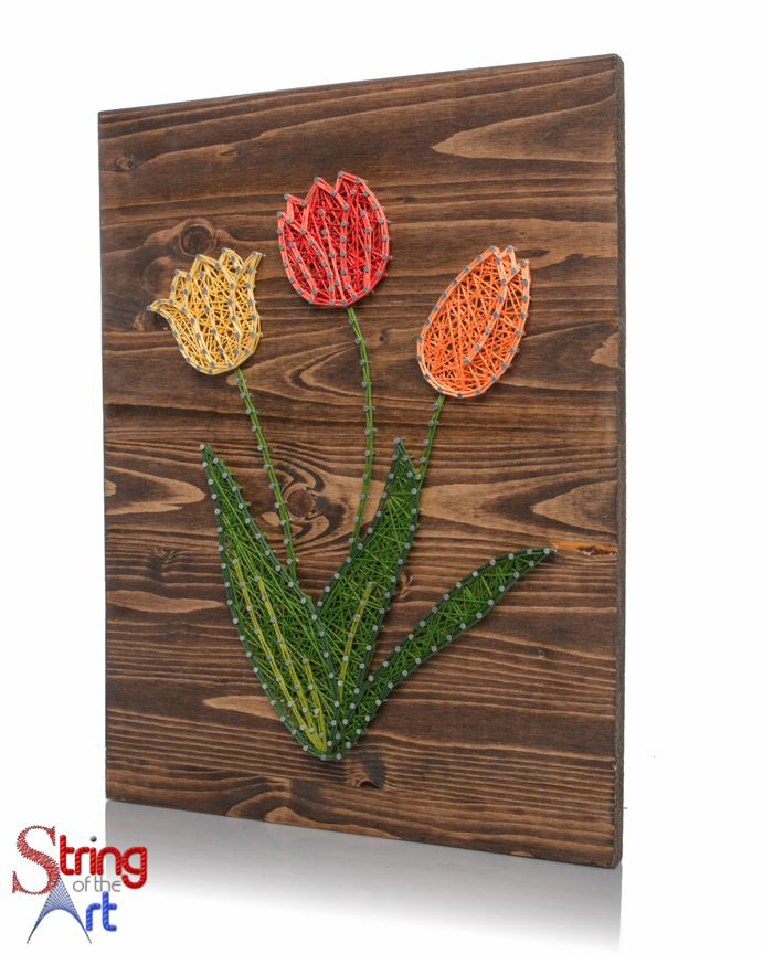 String Art DIY Kit. Yellow, Red, and Orange Tulips. Home Decor. Flower Decor. Tulip Decor. DIY Decor. DIY Crafts String Art Crafts. Visit www.StringoftheArt.com to learn more about this DIY Kit. Supplies includes HAND sanded and HAND stained pine wood board, highest quality embroidery floss, easy to follow instructions, and a pattern template.