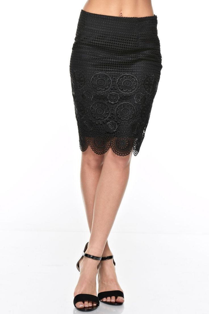 BLACK COLLECTION 'Sainte Maxime' Skirt - Try to be a saint in this pretty above-the-knee length black skirt all year round! It's impossible to not fall in love with this straight skirt that features a floral lace knee length overlay. The skirt also has an easy side zip closure. Whether you're in the Gulf of Saint-Tropez or just at a local event, this stunning skirt works for weddings, charity events and date nights! Available in Black. By the Black Collection.