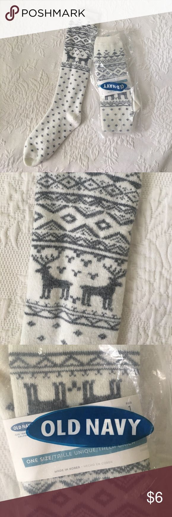 Old Navy Fair Isle boot socks These brand new with tags boot socks are ivory with a gray fair isle reindeer pattern. They are so cozy under boots in the winter or to keep your legs warm when you're lounging at home. (Photo of unwrapped sock is not the actual item being sold but shown for representation. Each pair offered for sale is new and never been removed from the package). Old Navy Accessories Hosiery & Socks