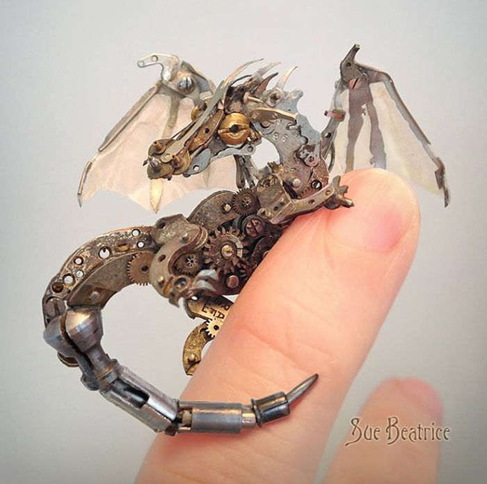 """Susan Beatrice is a talented artist who creates these beautifully intricate sculptures from old vintage watch parts. She says that her recycled sculptures are """"Earth-friendly and artistic items sen…"""