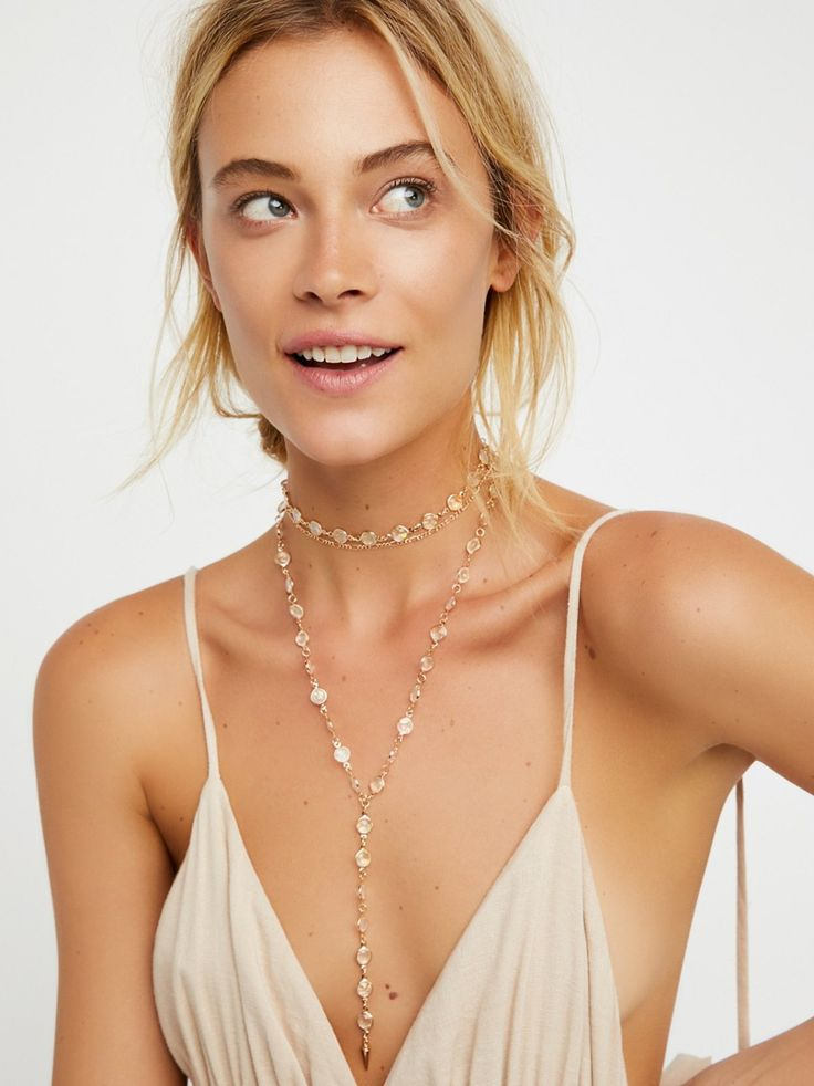 Nucleus Stone Wrap Bolo | Bolo style metal necklace featuring circular iridescent stone detailing. Adjustable lobster clasp closure.