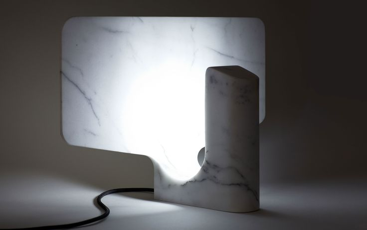 Flap by Cédric Ragot – Lamp : The preciousness of this lamp comes from the marble block's memory from which it was extracted. The marble integrates the functions of reflector, shade, structure geometry in a single carrier.