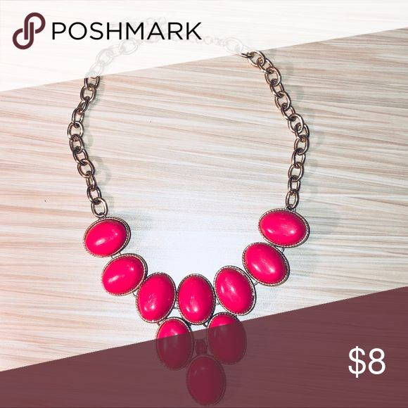 Hot Pink Statement Necklace Not very long; meant to be worn under the collar bone. Makes for a great accent to any outfit! Color is a true hot pink, even though the picture makes it look a little darker. In great condition because it's only been worn once or twice. Charlotte Russe Jewelry Necklaces