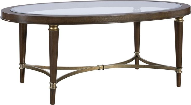 Kirsten Cocktail Table   The easy lines of the oval Kirsten Cocktail Table bring sophistication to your living room, dressing it up a bit while providing a useful surface for everyday activities as well as special weekend occasions. It offers transitional styling with a glass insert top, hardwood solids, walnut veneers, and metal stretchers for a distinct look.