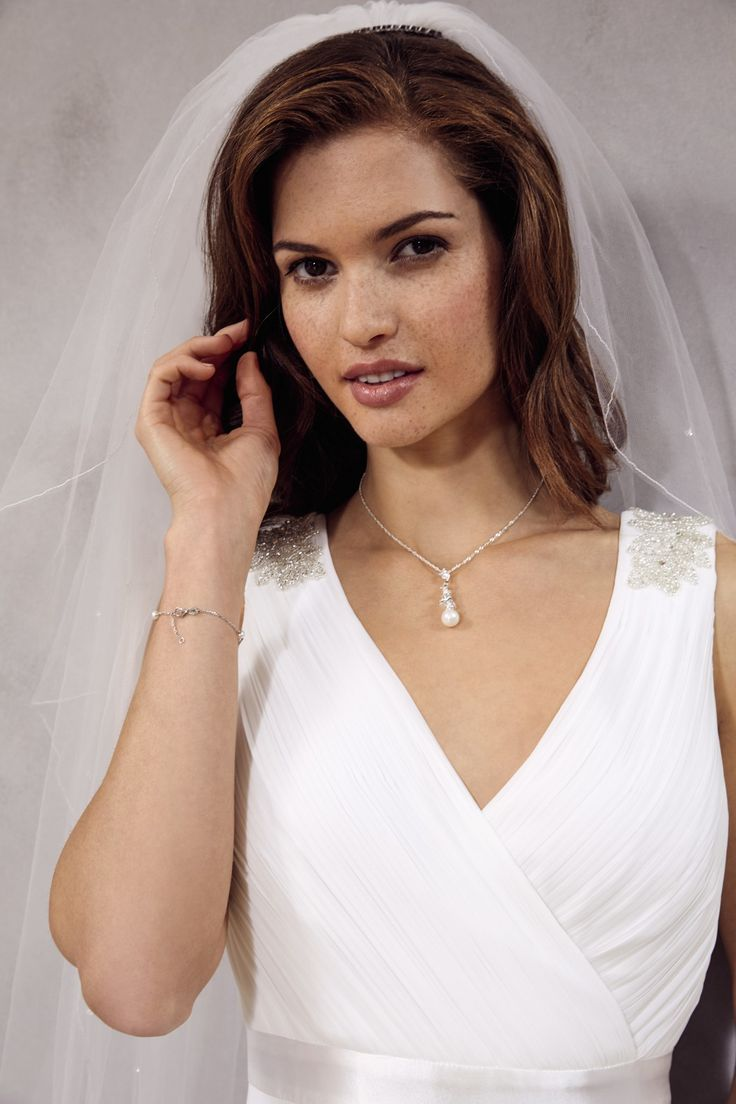 Complete the look with stunning pieces of bridal jewellery by Jon Richard.