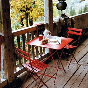 The red patio set looks lovely with the natural wood