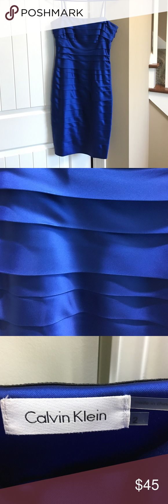 Calvin Klein Blue Dress Worn once. Removable and adjustable spaghetti straps. Side zipper. Royal blue. High quality dress. Silky satin. Holds form well. From smoke free and pet free home. Calvin Klein Dresses Midi