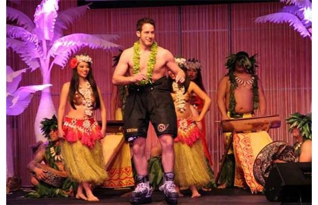 Celebrity emcee Stuntman Stu makes his grand entrance at the aloha-themed 2012 Ferguslea Sens Soirée.