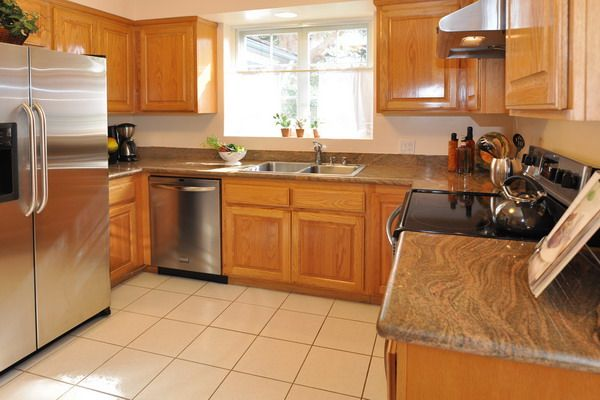 Honey oak cabinets with stainless steel appliances my for Black and oak kitchen cabinets