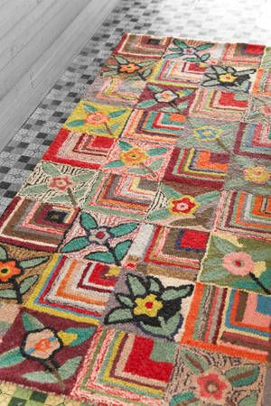 This is a hooked rug. I love the colors and different pattern designs; could be pretty easily interpreted in knitting or crochet I think!
