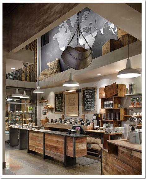 STARBUCK  O projeto abaixo é de uma das lojas em Seattle, bem rústica, com muita madeira, tons terrosos e esverdeados, grãos e sacos de café a mostra. Esse é o estilo que eu acho que combina com uma cafeteria, simples, rústico e aconchegante. Voilà!