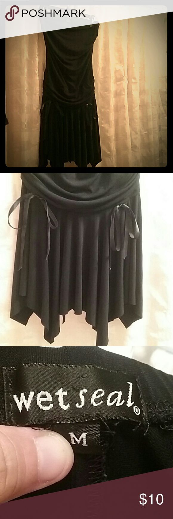 :)?? $10 Deal.  WET SEAL Tube top LBD Dress is tube top dress, ruffled on bottom, Has 4  string bows to tie: 2 in front and 2 in back, 92 % Polyester, 8% Spandex, Gently worn, No holes, stains, wrips, or snags, this dress i used for Halloween a couple of years ago as a witch. Makes a great WITCH Costume. VERY SEXY AND GREAT WITH HEELS. :) Wet Seal Dresses Strapless