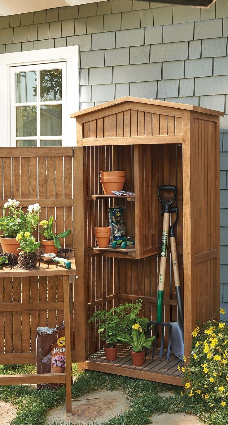 Crafted from high-quality teak that's naturally impervious to moisture, this charming storage cabinet keeps your short- and long-handled tools, potting supplies and other landscaping essentials close at hand while you work in your garden.