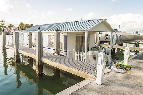 Oh I want this little houseboat...cute inside and out and for sale!