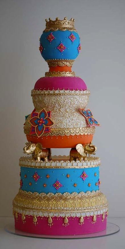 Intricate Indian wedding cake, check out the little golden elephants!