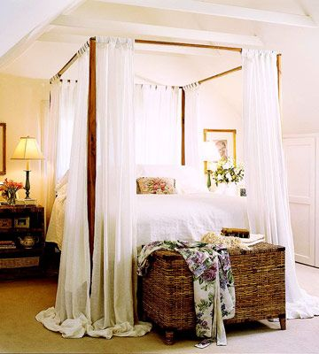 Beautiful Bedroom with Puddles of fabric hanging from the canopy...love the chest at the foot of the bed, etc...
