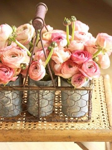 Pink rununculas in the most fab basket and tin cans - does it get prettier?