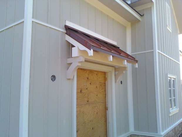 Side door awning replacement overhangs pinterest for Vertical siding on house