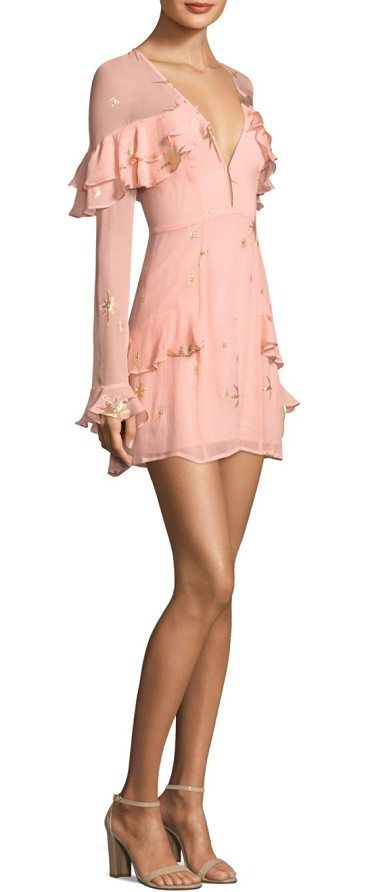 gilded star mini dress by For Love & Lemons. Metallic star patterned dress with ruffle trim.V-neck. Long sleeves. Back keyhole with button closure. Concealed back...