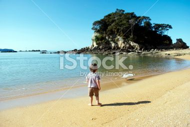 Child and Seascape, Kaiteriteri Beach, NZ Royalty Free Stock Photo