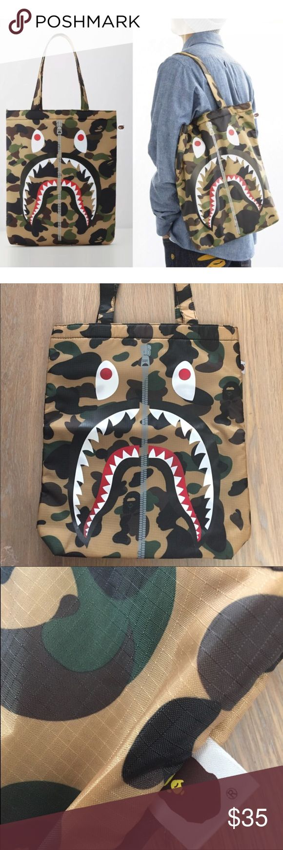"A Bathing Ape BAPE Shark Camo Padded Tote Bag Brand new without tags / bag only / no magazine Authentic from E Mook Japan collaboration with BAPE A small tote / shoulder bag Small size L 13"" x H 14.5"" x W 3"" (Model is about 5'7 in pic) Tan brown camouflage printed grid microfiber Padded body  Please do not compare quality with A Bathing Ape / BAPE store because this is a magazine appendix Bape Bags Totes"