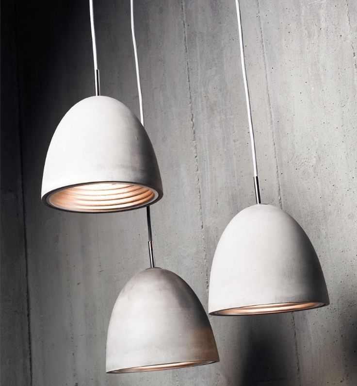 """""""A beautifully textured cast concrete exterior with anodised silver interior...The """"concrete"""" range will add warmth, texture and beauty to any contemporary environment"""". Designed by Paul Mulhearn and available in S, M, L and conical sizes, these lights are just so classy and beautiful. Find them here:http://www.golights.com.au/catalogsearch/result/?cat=0&q=concrete #interior #design #lighting #lights #concrete #pendants #golights"""