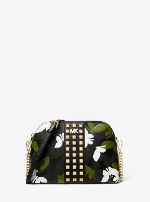 615640106d09 This crossbody channels the season's urban-femme mood in a butterfly camo  print contrasted by