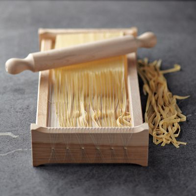 This beautifully crafted tool originated in Abruzzo, Italy, more than a century ago. It produces homemade noodles the traditional way—by pressing rolled sheets of pasta dough against tightly strung wires reminiscent of the strings of a chitarra, or guitar.