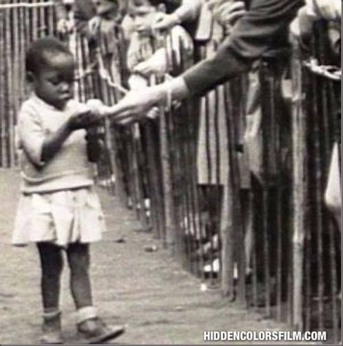 Did you know that there were Human Zoos on display in Europe and America from the 1870's to the 1950's? These public exhibits of humans,often called Negro Villages, usually showed indigenous people in a so-called natural or primitive state.  Above is a photo from Amsterdam Holland around 1890, of an African child in one of these Human Zoo exhibits,being fed like an animal by white spectators.