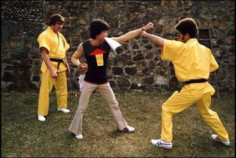 Bruce Lee practicing on the set of Enter the Dragon with Jim Kelly and Robert Byrd