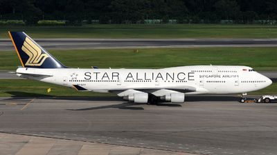 Singapore Airlines (SG) Boeing 747-412 9V-SPP aircraft, painted in ''Star Alliance'' special colours, skating at Singapore Changhi International Airport. 30/09/2011.