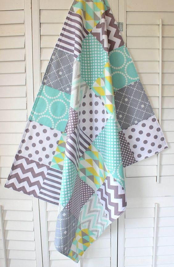 A lovely patchwork blanket, just like my Grandmother used to make.  This adorable blanket is perfect for that special little one in your life. Mint green, soft gray and a splash of lemon yellow dots, stripes and chevron zig-zags cover the front of this gender neutral blanket. ~ Measures approximately 30 x 36 inches (2 foot 6 inches x 3 foot) or 36 x 42 inches (3 foot x 3 foot 6 inches). Great for swaddling, play time, a stroller quilt or big enough for a toddler to enjoy!  ~ The front is…
