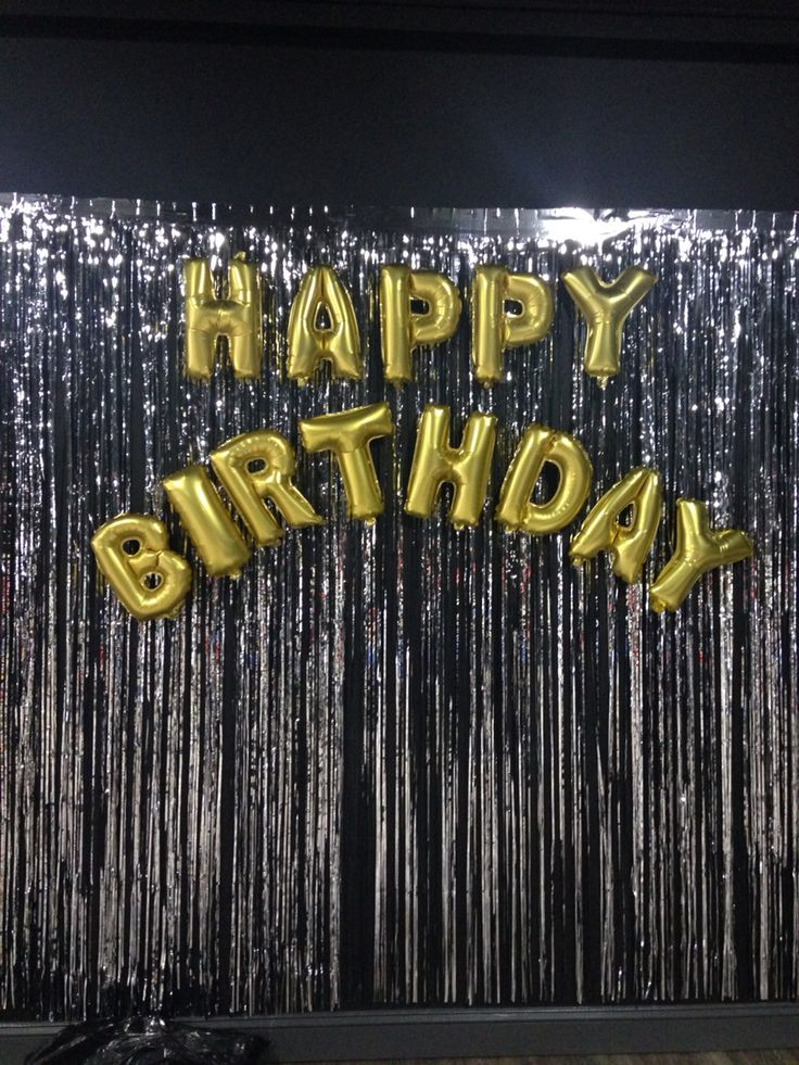 Inexpensive foil curtain. Mylar happy birthday balloons blown up & stuck to the curtain made the best photo spot!